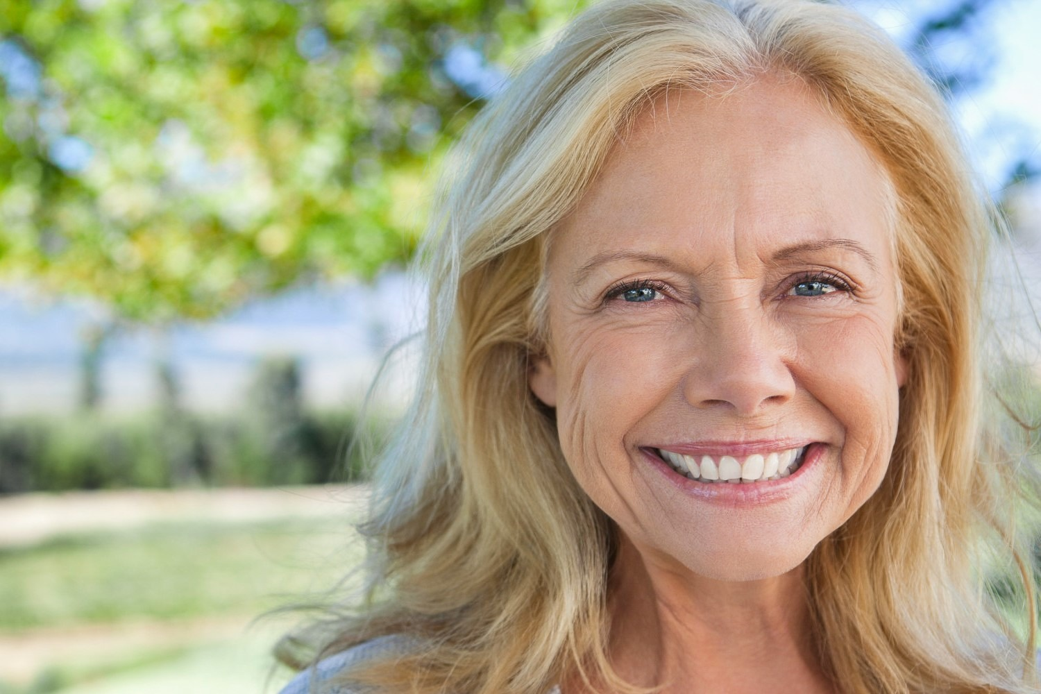 Happy middle aged woman with healthy skincare in Omaha, NE